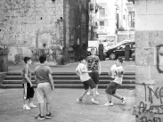 Young boys playing ball in a church yard (and cursing like sailors)