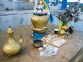 offerings to Buddha: money, biscuits, sweetened curd and...a coffee